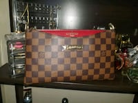 LV clutch. NEW! Calgary, T3C 2P7