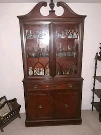 brown wooden framed glass display cabinet St. Louis, 63116
