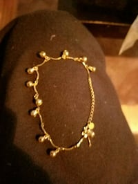 Gold colored anklet with bells on it. Minneapolis
