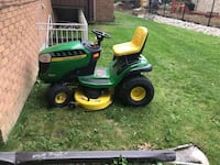 green and yellow John Deere ride on lawn mower Toronto, M6S