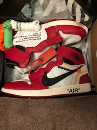 pair of red-and-white Air Jordan 1