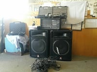 two black Peavey speakers with amplifier