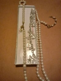 Pearl necklace with. .Guardian Angel bracelet..