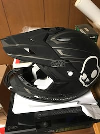 black and white motocross helmet