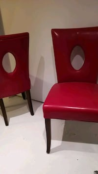 two red leather padded chairs Toronto, M4C 4S7