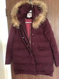 red and brown zip-up parka jacket