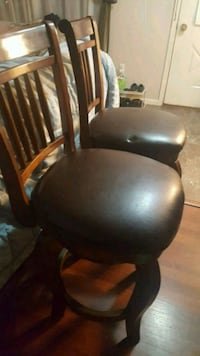 black leather padded rolling armchair Lorton