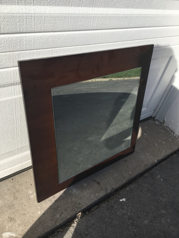 Square wooden framed wall mirror
