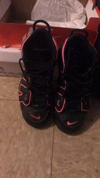 pair of black-and-red Nike basketball shoes New York, 10473