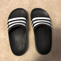pair of black-and-white Adidas slide sandals