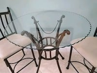 round glass top table with black metal base Port St. Lucie, 34953