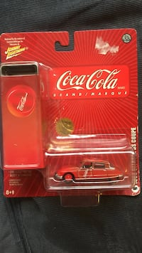 Johnny Lightning Coca-Cola die-cast toy car in blister pack