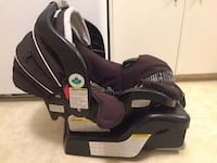 baby's black and gray convertible car seat carrier