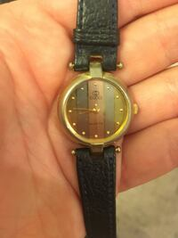Women's Gucci watch. Rose gold, gold, and silver striped face. Reginald leather band. Needs new battery.  Toronto, M4Y 0B7