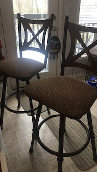 Two well built brown bar stools