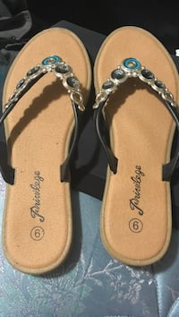 pair of brown-and-black sandals 583 km