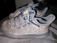 pair of gray Nike running shoes Mission, 78574