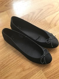 Pair of black suede flats