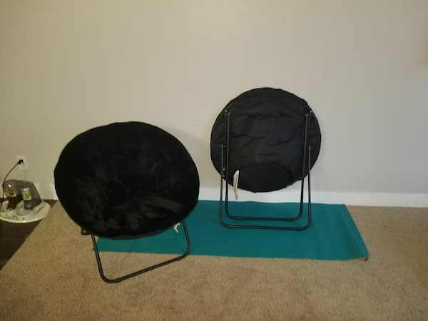 two black and blue moon chairs
