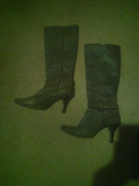 pair of black leather side-zip knee-high heeled boots Palm Bay, 32908