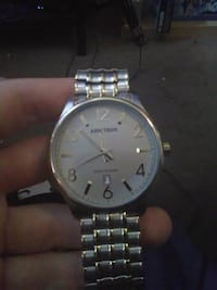 round silver analog watch with link bracelet