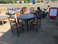 round brown wooden table with four chairs dining set Shreveport, 71118