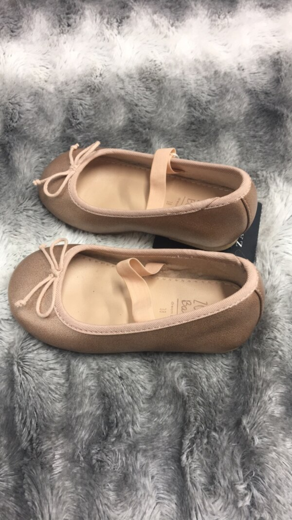 pair of brown leather flats