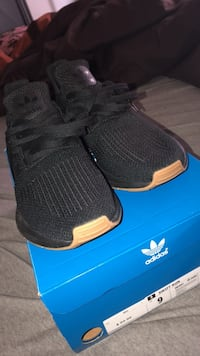 pair of black Adidas NMD shoes with box Pooler