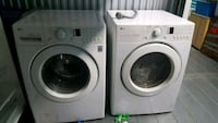 white LG front-load washer and dryer set Queens, 11423