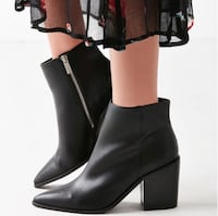 Pair of black leather side-zip booties Fairfax