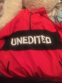 red and black Unedited pullover rain jacket  Montréal, H9H 1H1