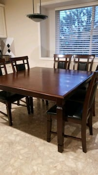 Solid Wood Integrated Center Leaf Table with 7 Leather and Wood Chairs