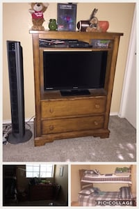 brown wooden TV hutch with flat screen television Bulverde, 78163