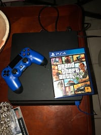 black Sony PS4 console with controller and game cases Dania Beach, 33004