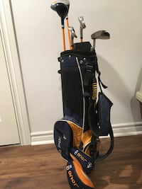Golf clubs and bag - boys junior w stand / wheels attached to bag