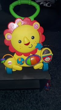 multicolored Fisher-Price Learning Lion Walker Montreal, H1G 2T4