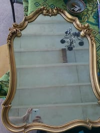 gold-colored frame mirror