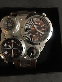 two round silver chronograph watches