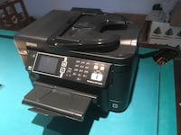 Epson color/black and white printer.  Has full ink cartridges and is ready to use