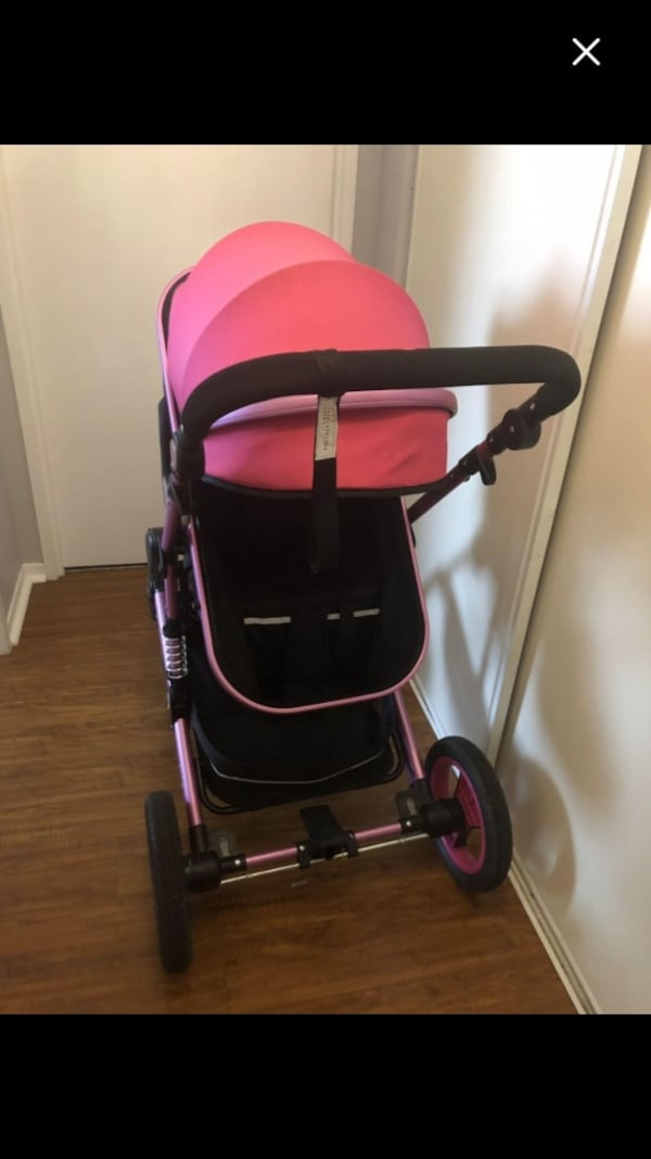 Pink and black stroller  2f39918a-4f0e-4736-8282-1038e5c16c49