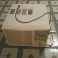 beige window type AC unit Ontario, M3B 1T4
