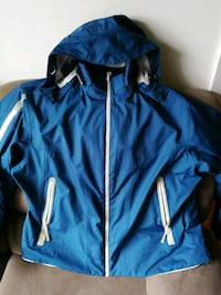 blue and black zip-up jacket null