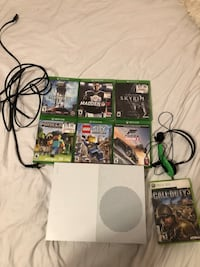 Xbox one s console with controller and game cases