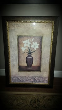 Brown frame with vase and white Lilys Lincoln