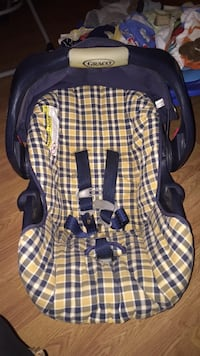 brown, black, and purple Graco car seat carrier