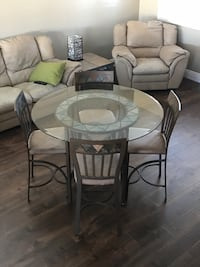 "Dining table and 4 chairs. Bar height 36"" Henderson, 89052"