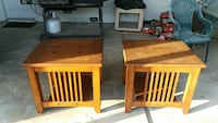 two square brown wooden coffee tables