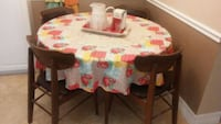 Round table  1970 teke wood table and chairs Sarasota, 34231