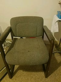 brown wooden framed gray padded armchair 77 km