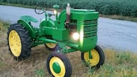 green and yellow John Deere ride on mower Rising Sun, 21911